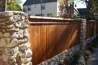 Wood privacy fence stone pillars and cedar wood